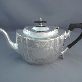 A Victorian sterling silver teapot by P Ashberry & Sons, hallmarked Sheffield 1895. Shaped oval design with bright cut decoration