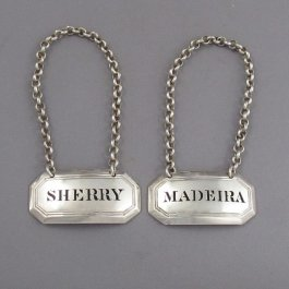 A pair of fine quality William IV antique sterling silver decanter labels for Madeira and Sherry, by Charles Riley and George Storer