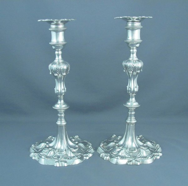 Pair of fine quality, early George III sterling silver candlesticks by Ebenezer Coker, London, 1763. Cast construction, hexagonal bases
