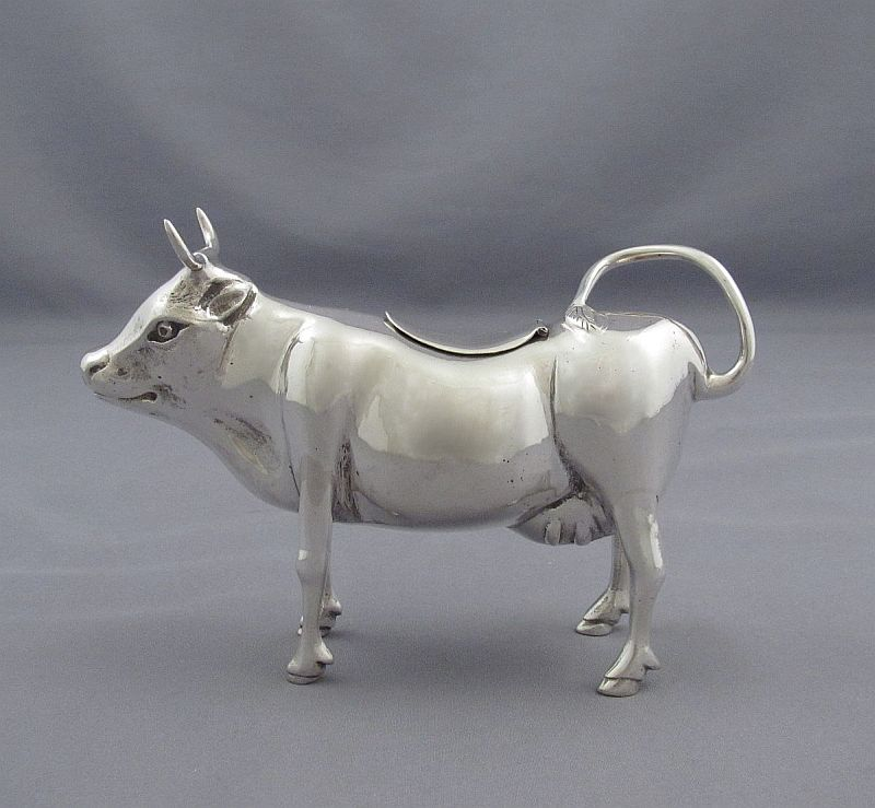 An Italian silver cow creamer (800 standard)by Giulio Coppini, Florence, c. 1930. Realistically modeled, with a hinged lid on