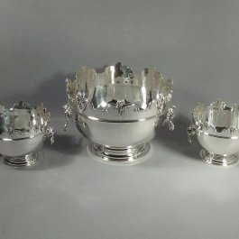 A rare set of three sterling English silver Monteith bowls by Crichton Brothers, hallmarked London 1912. A stunning suite of silverr