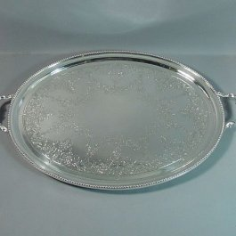 A Victorian sterling silver tea tray by Richard Martin & Ebenezer Hall, hallmarked London 1869. Oval with bead border