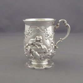 A fine quality early Victorian sterling silver christening mug by James Charles Edington, London 1851. With repoussé scene depicting a King Charles Spaniel