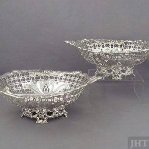 A pair of Victorian sterling silver baskets by Frederick Sibray & Job Frank Hall, hallmarked London 1890. Navette shaped bodies