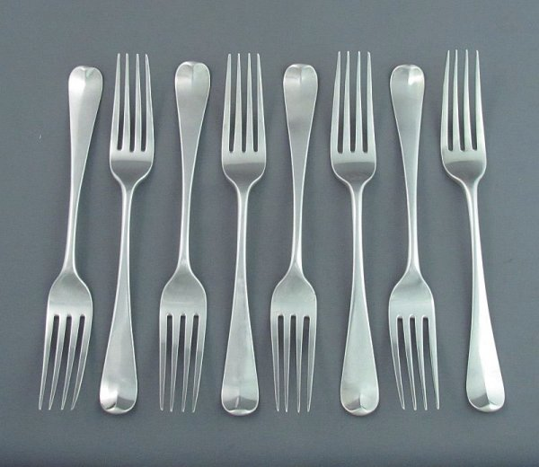 A set of eight George III sterling silver Old English pattern dinner forks (or table forks) by William Eley & William Fearn, hallmarked London 1802.