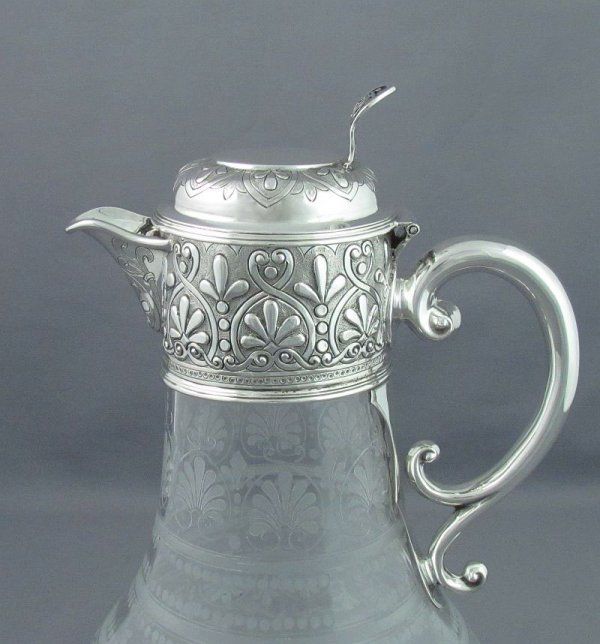 A Victorian silver claret jug by Walter & Charles Sissons, Sheffield 1876. Silver mount embossed with scrolls and anthemions