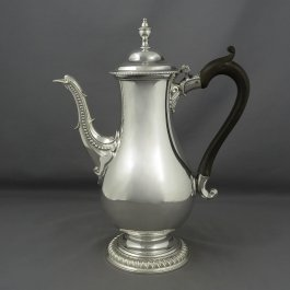 A George III silver coffee pot by Charles Wright, hallmarked London 1778. Baluster shaped with beaded scroll spout and double scroll