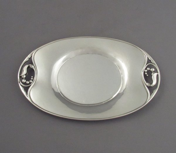 A beautiful Georg Jensen sterling silver sauce boat and under-plate with blossom motif, Copenhagen post 1945, design #177 and 177A