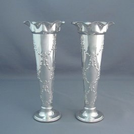 A pair of antique Edwardian sterling silver vases by George Nathan & Ridley Hayes, hallmarked Chester 1904.  Each trumpet shaped on