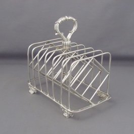 Superb quality George III Paul Storr silver toast rack in the Regency style, hallmarked London 1815. Seven bar wire-work frame