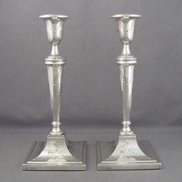 A large pair of English sterling silver candlesticks in the late 18th century style, by Crichton Brothers, hallmarked London 1919.