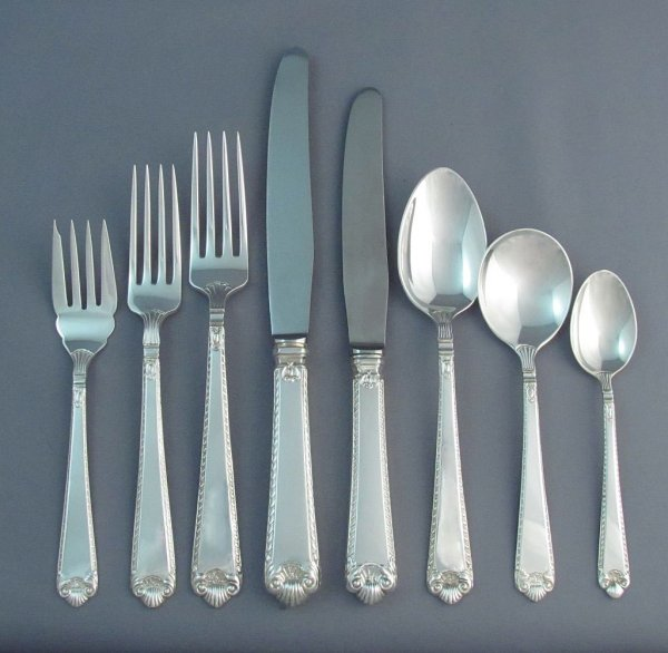 An extensive Birks sterling George II Plain pattern silver flatware service for eight, dinner and luncheon size with straight handles