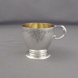 A sterling silver baby mug (or Christening mug) by Henry Birks & Sons, Montreal 1928. Tapered circular form on spreading foot