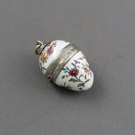A Viennese silver gilt and enamel vinaigrette by Ludwig Politzer, Vienna c. 1890. Egg shaped with flowers and foliage hand painted