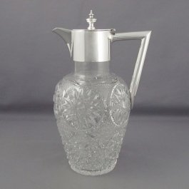 An antique sterling silver claret jug by Roberts & Belk, hallmarked Sheffield 1898. Silver collar, handle and lid with turned