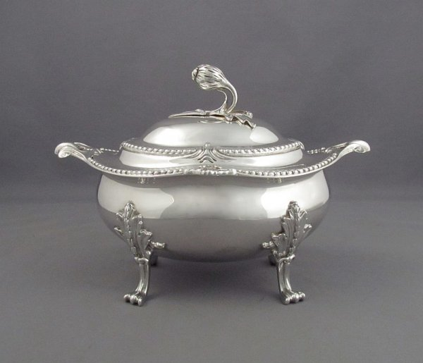 An English sterling silver sauce tureen by Crichton Bothers, London c. 1925 with Crichton Bothers New York retail mark. Rococo style