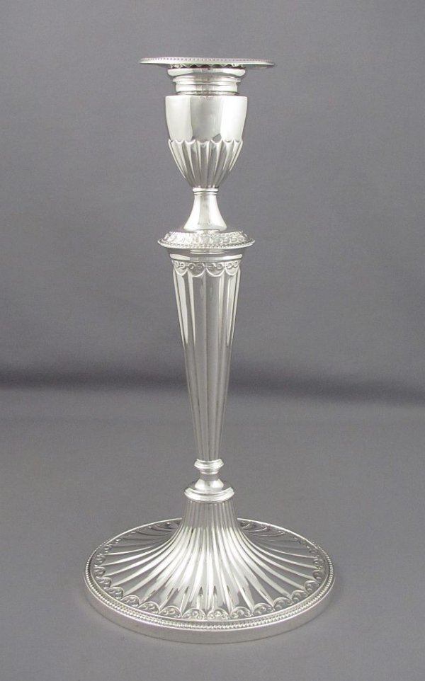 A pair of large antique sterling silver candlesticks in the late 18th century style by Gorham, Providence 1917. Fluted and tapered oval