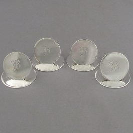 Set of four English sterling silver place card holders by Hasset & Harper Ltd, Hallmarked Birmingham 1933. Monogrammed B.