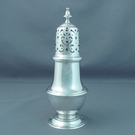 A large English sterling silver sugar caster hallmarked London 1949 by Richard Comyns. Baluster shaped with pierced lid.