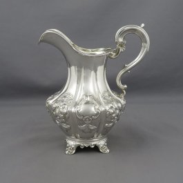 An antique Victorian sterling silver milk jug or cream jug by Samuel Hayne & Dudley Cater, hallmarked London 1846. Baluster shaped