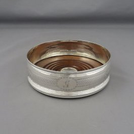 An attractive George III sterling silver wine coaster by Duncan Urquhart & Naphtali Hart, hallmarked London 1799.