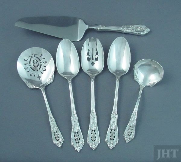 A sterling silver flatware set for 8 in Rosepoint pattern by Wallace, dinner size, comprising: