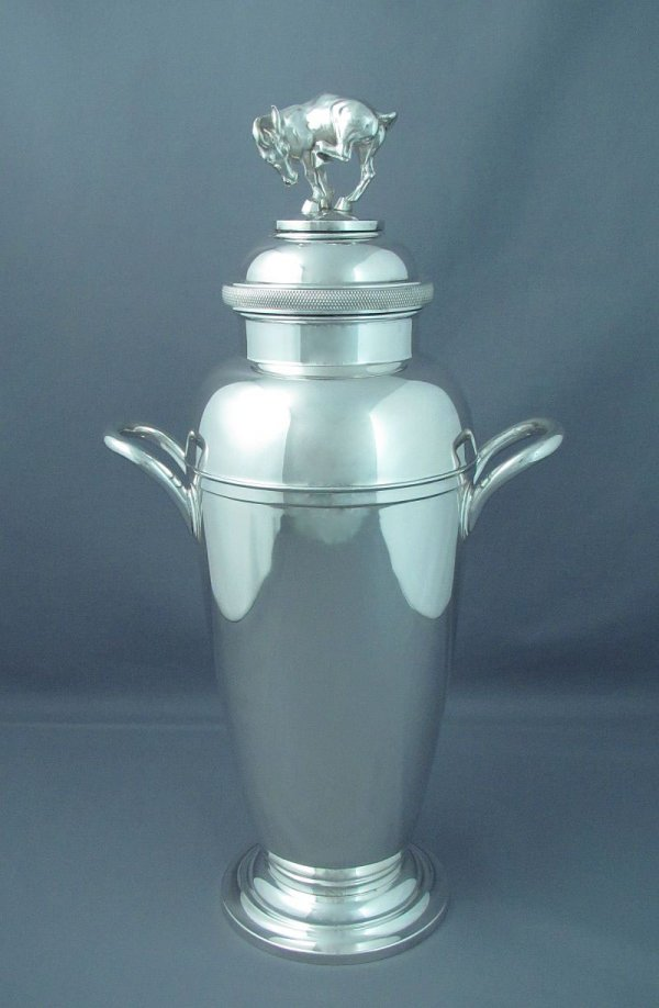 A massive and fine quality sterling silver cocktail shaker with figural finial by Watson Company of Attleboro Massachusetts c. 1930.