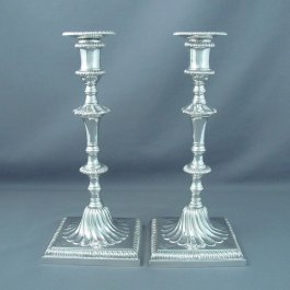A pair of heavy English cast sterling silver candlesticks by Richard Comyns, hallmarked London 1928.  Cast construction