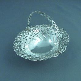 "George II silver sweetmeat basket, possibly by Thomas Pitts I (partial maker's mark ""T.""), hallmarked London 1759. Pierced oval body"