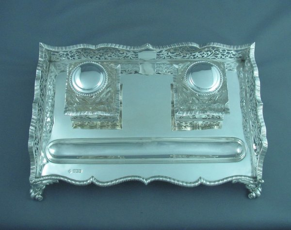 A massive Edwardian sterling silver inkstand by Martin Hall & Co, hallmarked  for Sheffield 1907. Rectangular shaped frame with pierced