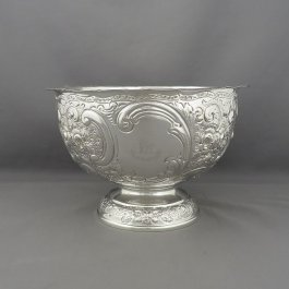 n antique English sterling silver rose bowl by Wakely & Wheeler, hallmarked London 1903. Hemispherical shape on pedestal base