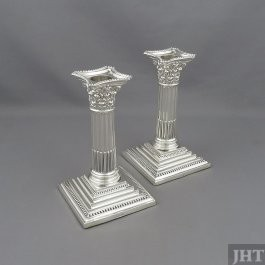 A pair of antique Edwardian sterling silver candlesticks by Walter Latham & Son, hallmarked for Sheffield 1908. Corinthian columns