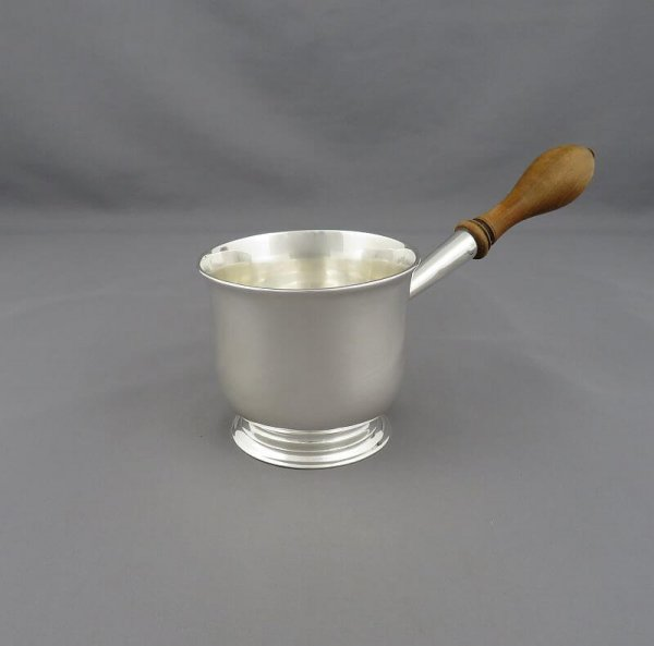 A George III sterling silver brandy warmer (saucepan) hallmarked London 1792, (no maker's mark). Cylindrical shape on ring foot with