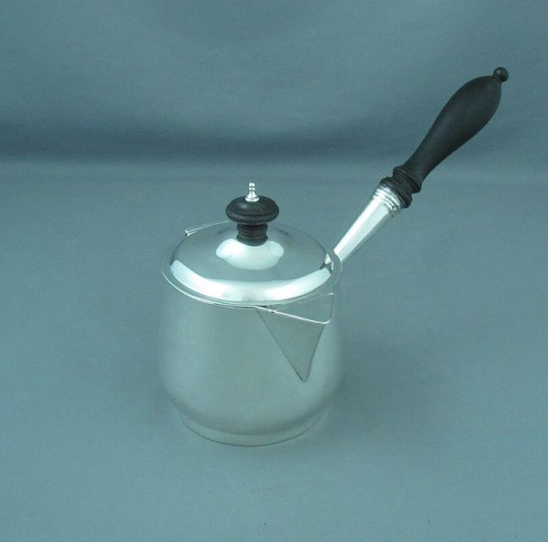 A George III sterling silver brandy warmer (saucepan) by Rebecca Emes and Edward Barnard, hallmarked London 1811. Tapered cylindrical