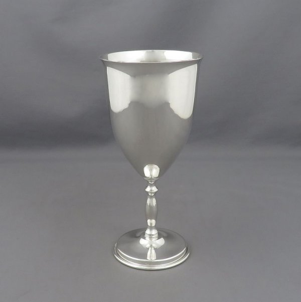 A heavy sterling silver wine goblet by Juvento Lopez Reyes, Mexico City c. 1960. Bell shaped bowl with baluster stem.