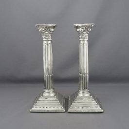 A pair of English sterling silver shabbat candlesticks by Alexander Smith, hallmarked Birmingham 1970. Corinthian columns with removable