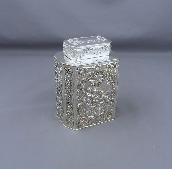 A German .800 silver tea caddy c. 1900 (also marked with a with Dutch tax-paid mark). Rectangular with cut-corners and pull-off lid