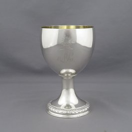 A large George III sterling silver goblet by Emick Romer, hallmarked London 1791. Tapering bowl on pedestal foot with gadroon border