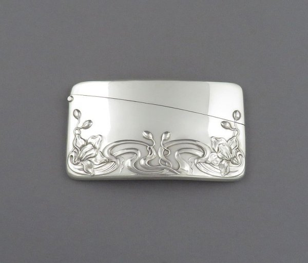An antique American sterling silver visiting card case, unknown maker, c. 1890. Rectangular shape with beautiful Art Nouveau