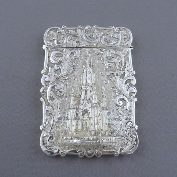 An early Victorian sterling silver castle top card case by Nathaniel Mills, hallmarked Birmingham 1841. embossed with scott memorial