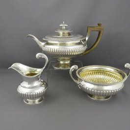 A fine quality Regency period sterling silver tea set by Samuel Hennell, hallmarked London 1811. Circular, half-fluted bodies with