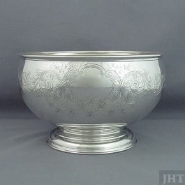 A heavy Birks sterling silver table bowl, made in Montreal in 1929. Hemispherical shape with molded border on spreading foot