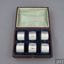 A rare set of six Victorian sterling silver napkin rings by John Round, hallmarked Sheffield 1892. Straight sides with engraved decoration